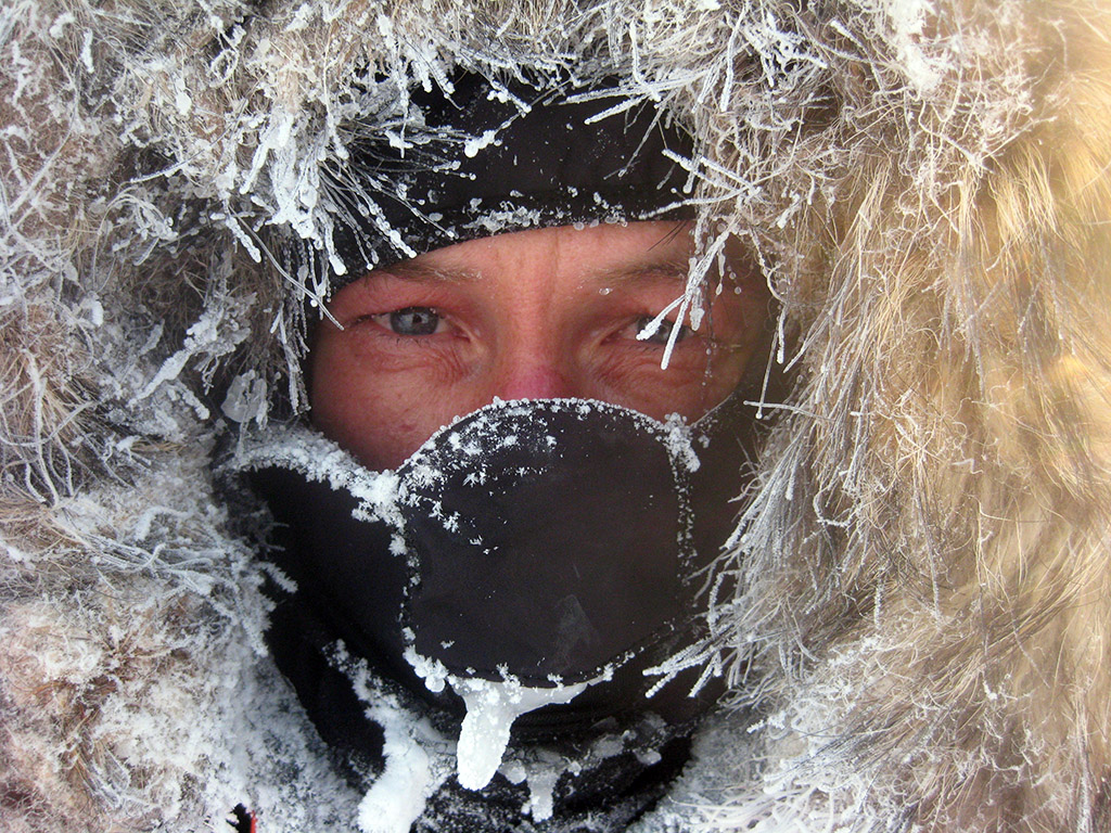 The fur hood creates a microclimate around Sebastian's face, while the steam of his breath freezes from the fifty below temperatures.