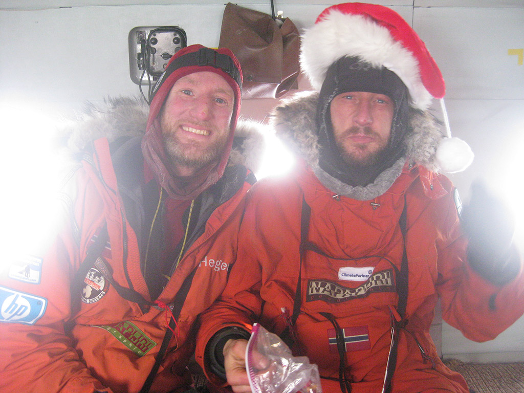 So Santa Claus left his hat at the North Pole! Keith and Sebastian, jubilant even if exhausted fill up on chocolate cookies in the helicopter on their way home.